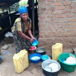 The Water Project: Rubana Yagilewo Community -  Cleaning Water Storage Containers