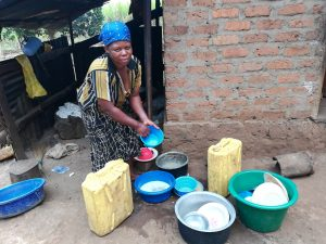 The Water Project:  Cleaning Water Storage Containers