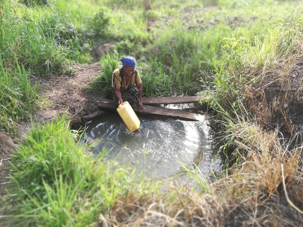 The Water Project : uganda19283-filling-container-at-an-open-source