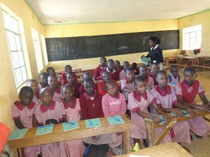 The Water Project:  Passing Out Notebooks To The Students
