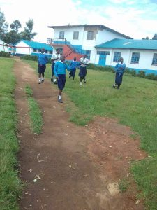 The Water Project:  Students Rushing To Use The Latrines During Break
