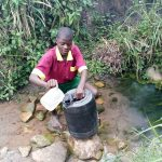 The Water Project: Nanganda Primary School -  At The Spring Used When The Well Is Dry