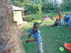 The Water Project:  Little Boy Using Leaky Tin