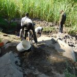 The Water Project: Bukhaywa Community, Asumani Spring -  Mixing Cement For The Spring