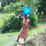 The Water Project: Buyangu Community, Osundwa Spring -  Joyce Carrying Water Home