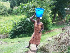 The Water Project:  Joyce Carrying Water Home