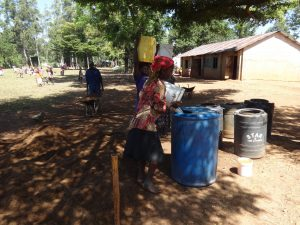 The Water Project:  Women Delivering Water To Mix Cement