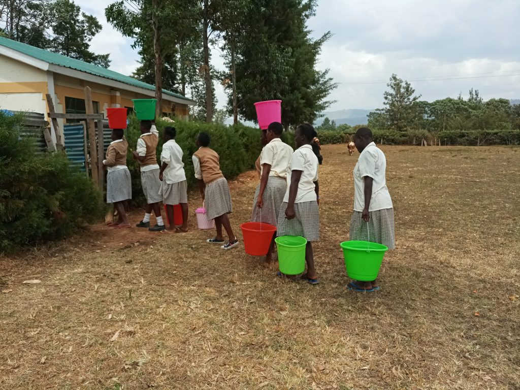 The Water Project : 11-kenya19045-carrying-water-back-to-school