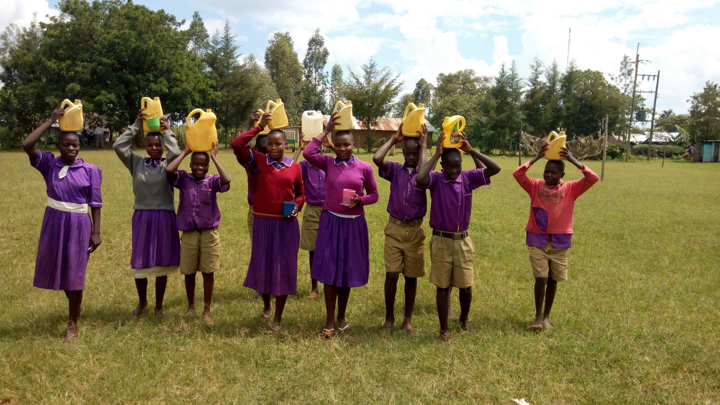 The Water Project : 11-kenya19057-students-posing-with-their-water-containers