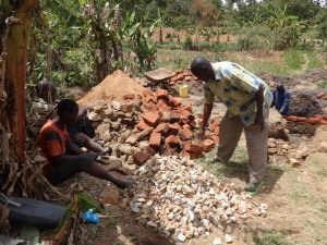 The Water Project:  Breaking Up Stones For Construction