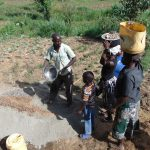 The Water Project: Musango Community, Mwichinga Spring -  Delivering Stones To The Artisan