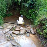 The Water Project: Shamakhokho Community, Imbai Spring -  Fetching Water
