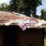 The Water Project: Bumavi Community, Joseph Njajula Spring -  Clothes Drying On Rusty Roof