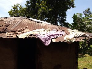 The Water Project:  Clothes Drying On Rusty Roof
