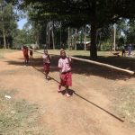 The Water Project: Irobo Primary School -  Students Bringing A Large Piece Of Wood To Make A Ladder
