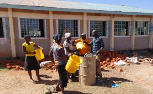 The Water Project:  Community Members Delivering Water