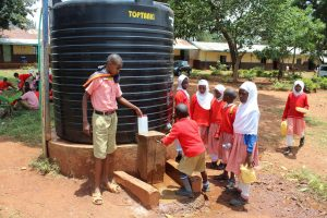 The Water Project:  Rationed Plastic Tank Water