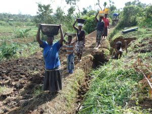 The Water Project:  Women Bringing Materials To The Site