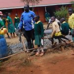 The Water Project: Majengo Primary School -  Students Carrying Water For Mixing Cement