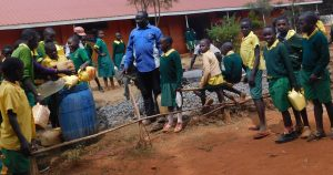 The Water Project:  Students Carrying Water For Mixing Cement