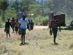 The Water Project:  Pupils Carrying A Brick From Home To School