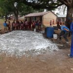 The Water Project: Irobo Primary School -  Mixing Cement