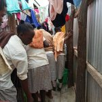 The Water Project: Kimangeti Girls' Secondary School -  Delivering Water To The Bathing Stalls