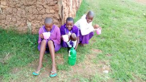 The Water Project:  Girls Drinking The Water