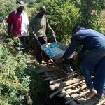 The Water Project: Lukova Community, Wasike Spring -  Transporting Materials To The Spring