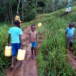 The Water Project: Shamakhokho Community, Imbai Spring -  Carrying Water