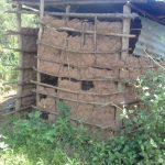 The Water Project: Lusiola Community, Ifetha Spring -  Mud Latrine