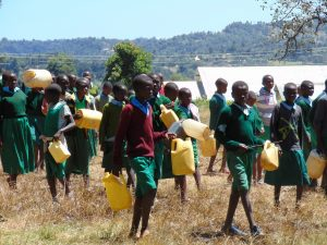 The Water Project:  Pupils Delivering Water To Mix Cement