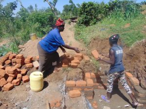 The Water Project:  Woman Helping The Artisan
