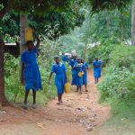 The Water Project: Kegoye Primary School -  Students Bringing Water To The Artisans For Mixing Cement