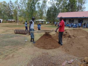 The Water Project:  Sifting Sand To Be Used For Cement