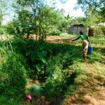 The Water Project: Ebutindi Community, Esilaba Anjere Spring -  Carrying Water