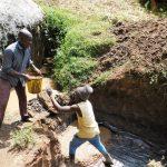 The Water Project: Ngeny Barak Community, Ngeny Barak Spring -  Casting The Foundation
