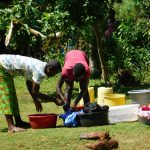 The Water Project: Ebutindi Community, Esilaba Anjere Spring -  Using Spring Water To Do Laundry