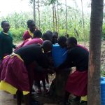 The Water Project: Nanganda Primary School -  Crowded Around A Handwashing Station