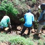 The Water Project: Musango Community, Mwichinga Spring -  Backfilling