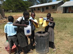 The Water Project:  Students Delivering Water For Mixing Cement