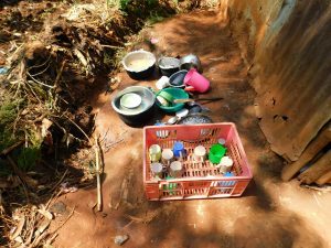The Water Project:  Dishes Drying On Ground