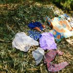 The Water Project: Ebutindi Community, Esilaba Anjere Spring -  Clothes Drying On Ground