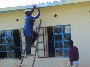 The Water Project:  Tito The Artisan Installing The Gutter System