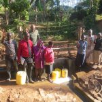 The Water Project: Rosterman Community, Kidiga Spring -  Flowing Water