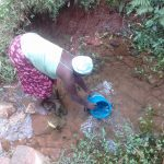 The Water Project: Imusutsu Community, Ikosangwa Spring -  Fetching Water