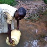 The Water Project: Bumavi Community, Joseph Njajula Spring -  Vivian Fetching Water