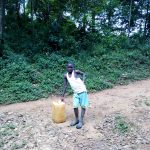 The Water Project: Bumira Community, Madegwa Spring -  Boy With Water Container