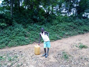 The Water Project:  Boy With Water Container