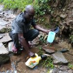 The Water Project: Jivuye Community, Wasiva Spring -  Fetching Water
